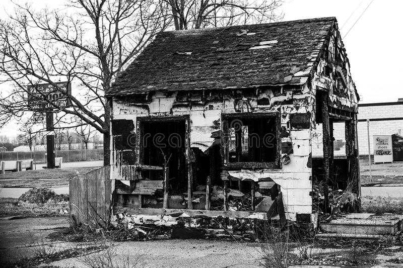 Burnt building in flint michigan. Abandoned burned building in flint Michigan urban decay and over growth black and white stock photography