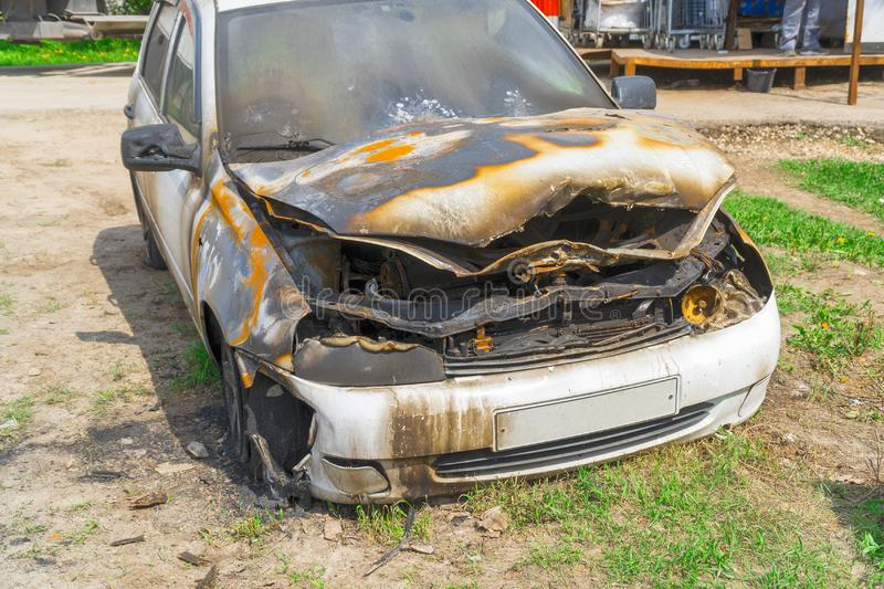 Burnt car on the street royalty free stock image