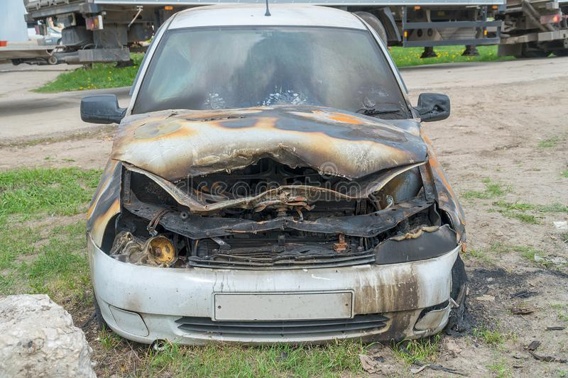 Burnt car on the street stock images