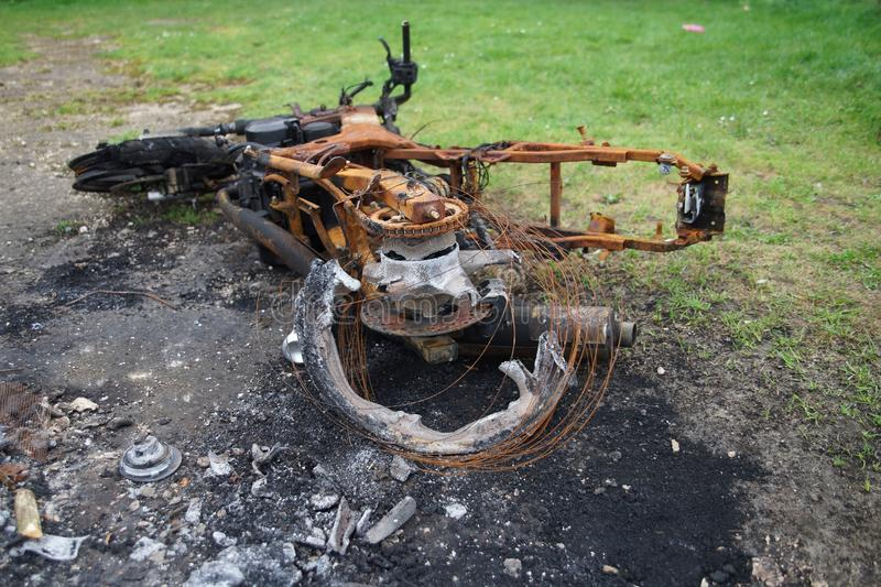 Burnt down motorbike royalty free stock photography
