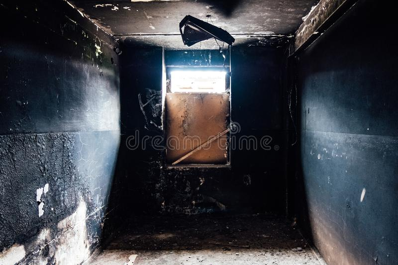 Burnt empty room. Charred walls in black soot.  royalty free stock image