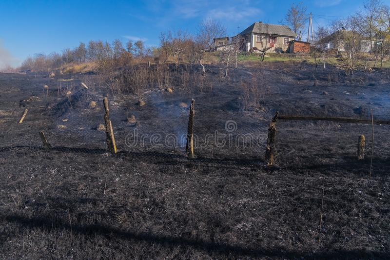 Burnt grass, the scorched earth, fire, disaster, landscape fire stock photography