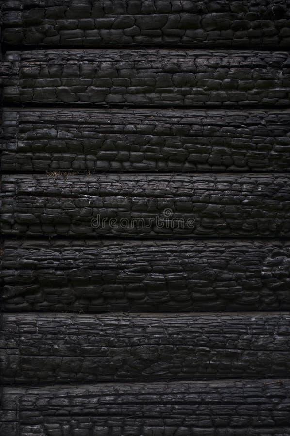 Burnt Log Wall Stock Image