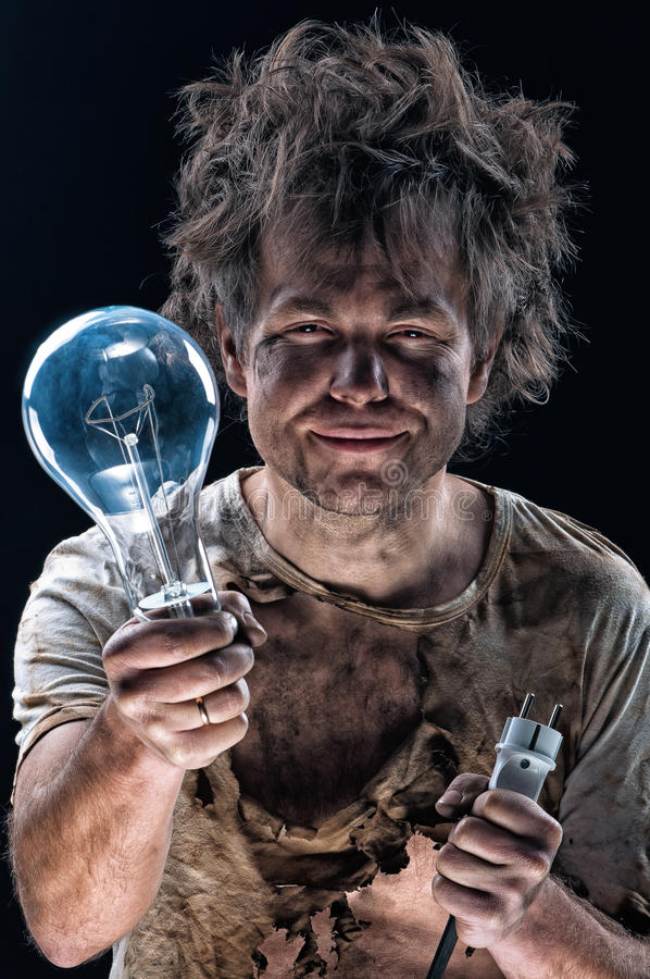 Burnt man with light bulb stock images