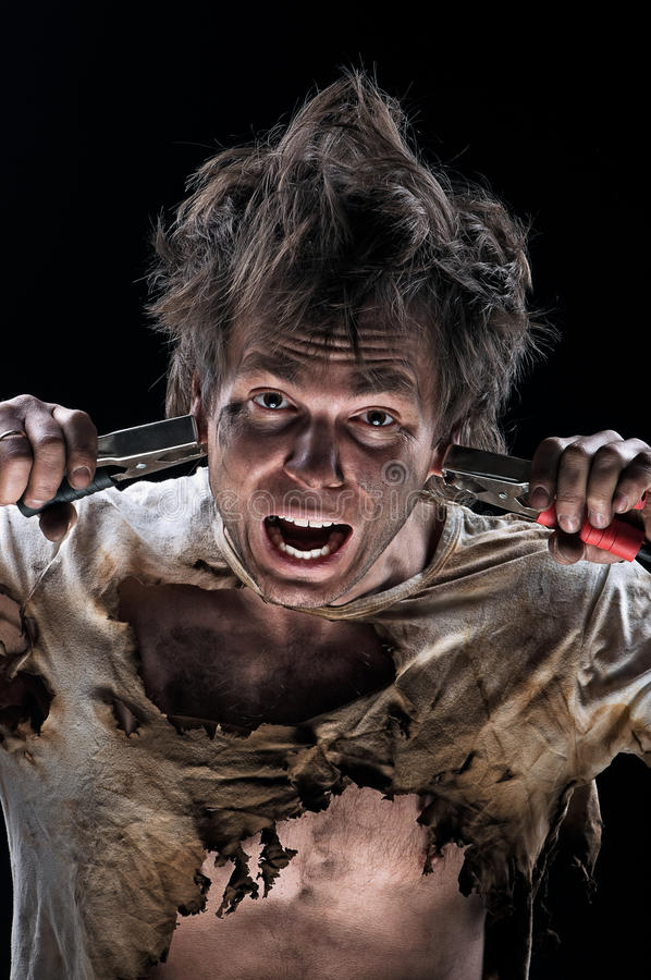 Burnt man. Portrait of crazy electrician over black background royalty free stock photo