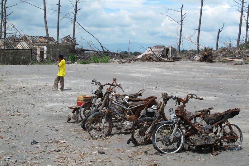 Burnt motorbike wrecks after volcano eruption royalty free stock photo