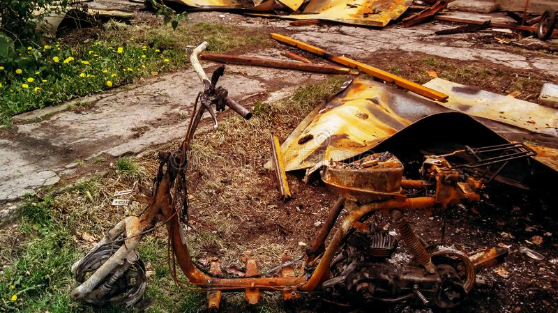 Burnt motorcycle is rusty and insurance matters stock images