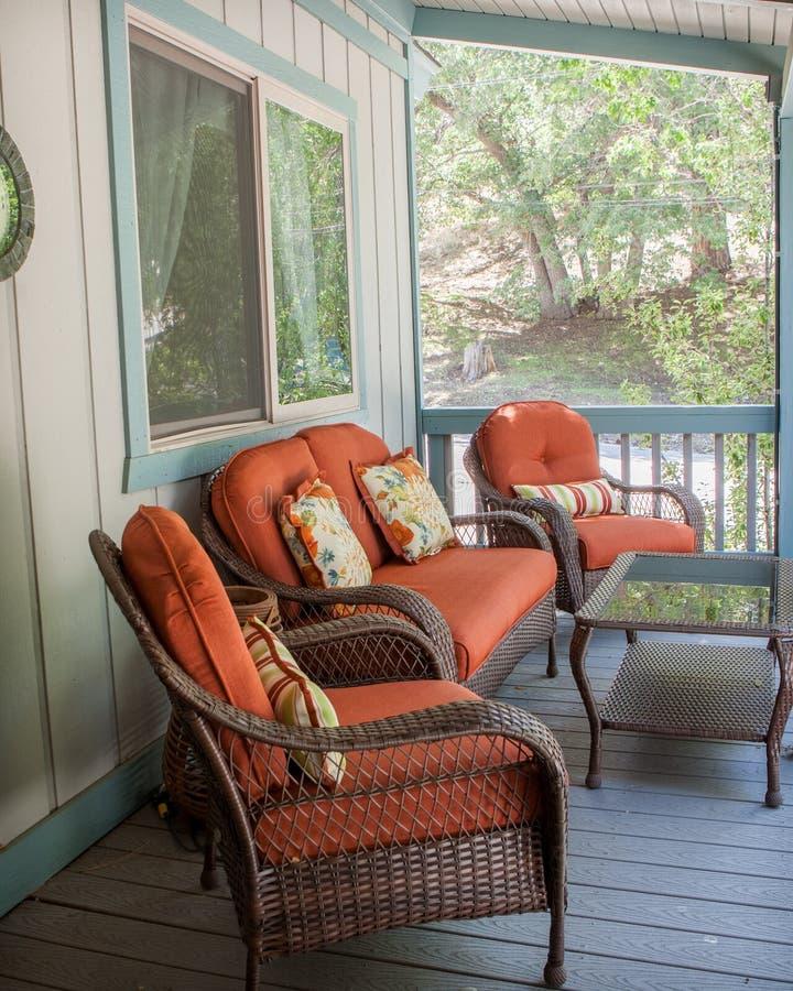 Burnt orange patio furniture outside on the deck stock photo