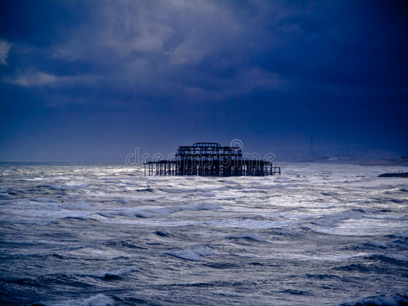 Download A Burnt Out Pier In The Sea Stock Photo - Image of broken, lonely: 16412510