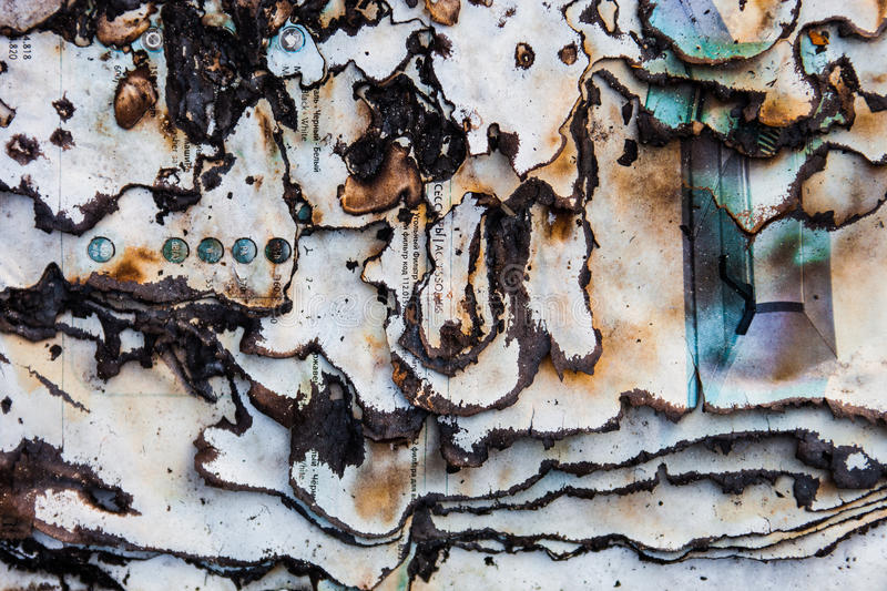 Burnt paper surface with dark charred page edges.  stock photography