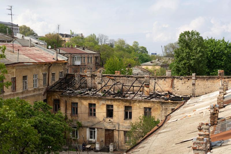 The burnt roof of the house is the result of a fire in the Old Town. Odessa. Ukraine stock images
