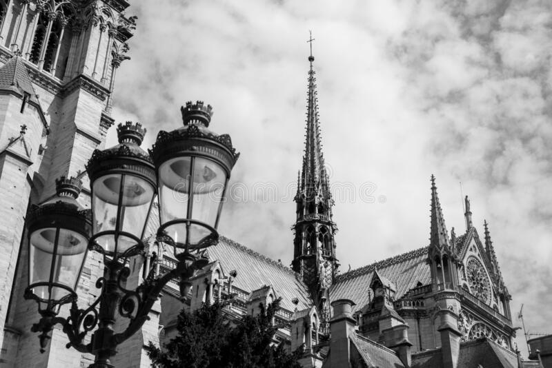 The burnt spire of Notre Dame de Paris black and white photo stock photography