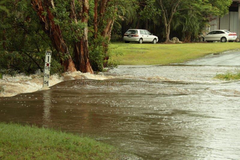 Burpengary home cuttoff by flood. BRISBANE, AUSTRALIA - JAN 25 : One year on Brisbane flooding again, Burpengary home cuttoff by flood January 25, 2012 in royalty free stock image