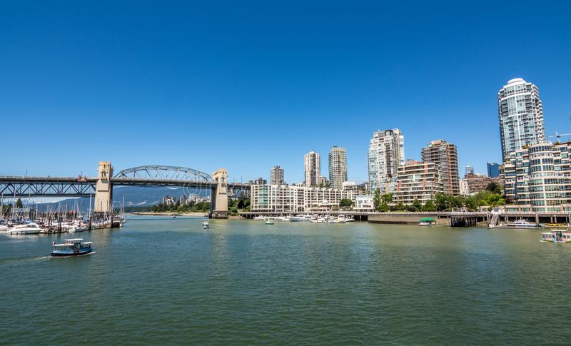 Burrard bridge and Marina with Vancouver`s downtown in the background stock image