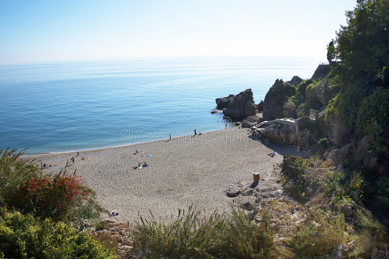 Burriana Beach at the Spanish resort of Nerja on the Costa del Sol. One of the seven beaches in Nerja in Andalucia in Southern Spain royalty free stock images