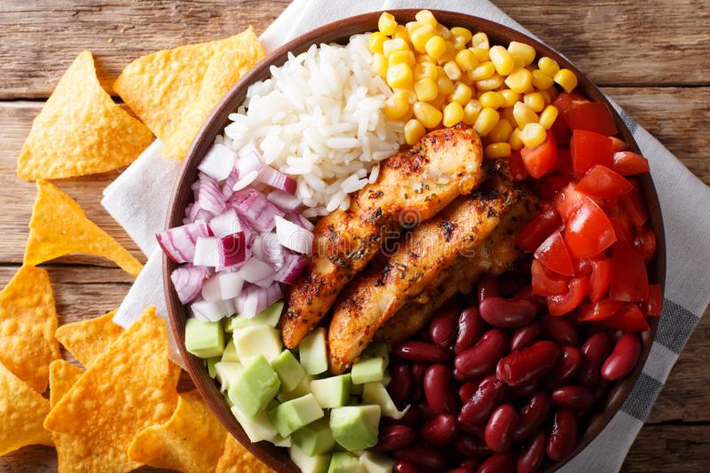 Burrito bowl with chicken grilled, rice and vegetables close-up. horizontal top view, Mexican style royalty free stock photos