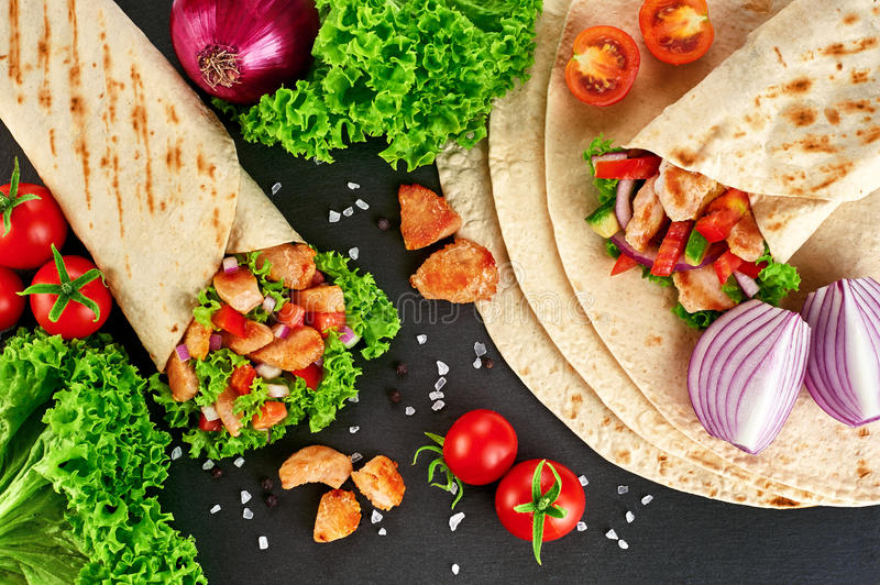 Burrito with grilled chicken and vegetables (fajitas, pita bread royalty free stock photo