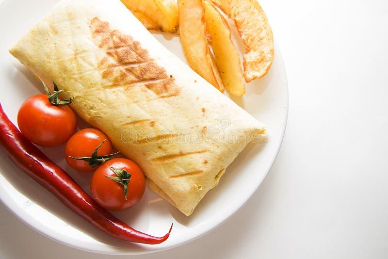 Burrito met gebraden aardappel op wit royalty-vrije stock afbeelding