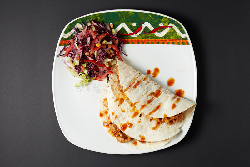 Burrito. Mexican food. Mexican cuisine. Studio shot on dark or black background royalty free stock photography