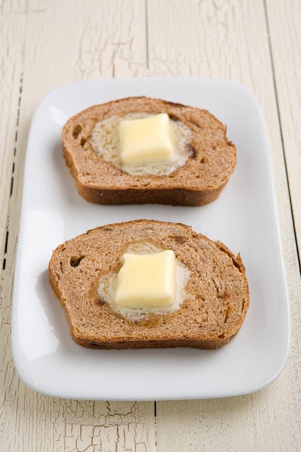 Burro del pane di uva passa della cannella immagine stock