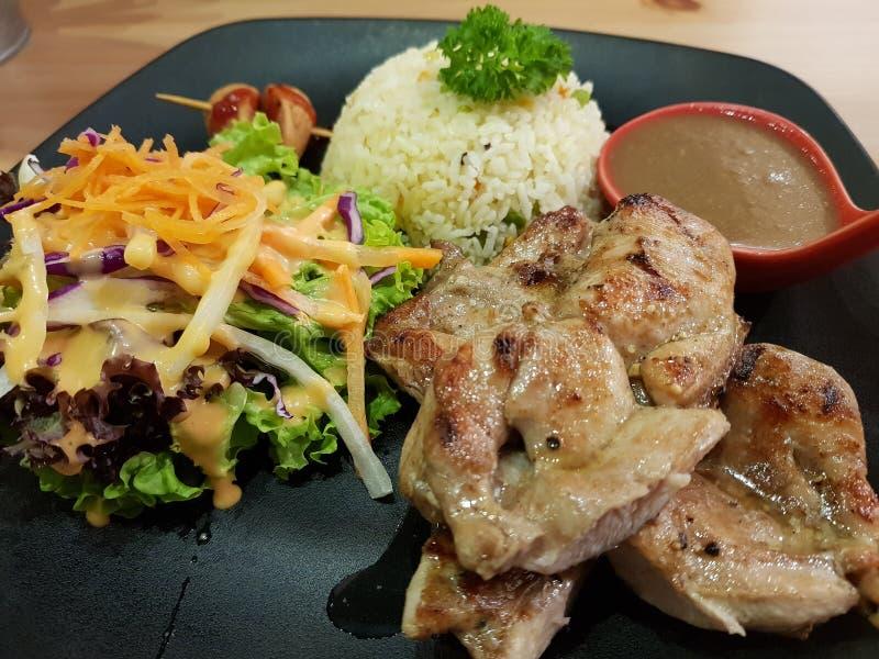 Burro del pollo con riso fritto fotografie stock