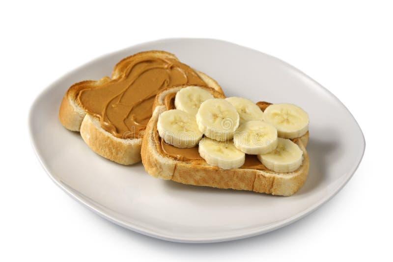 Burro di arachide e pane tostato della banana immagini stock libere da diritti