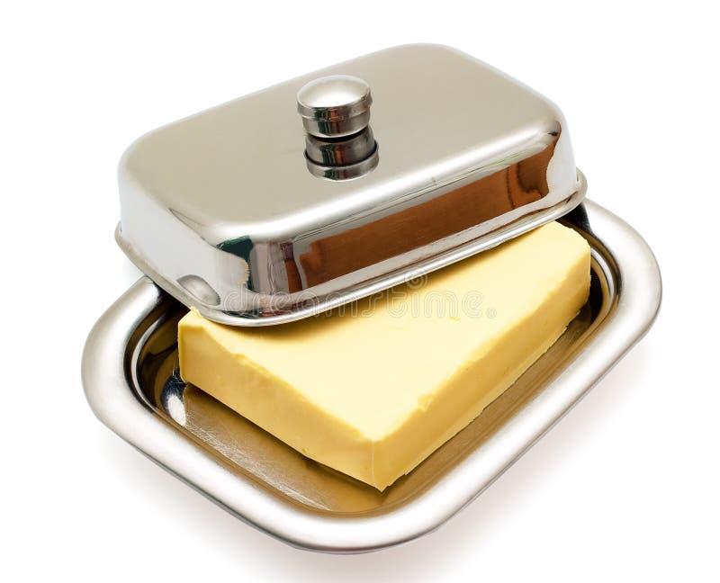 Burro sul piatto di burro d'argento isolato fotografia stock libera da diritti
