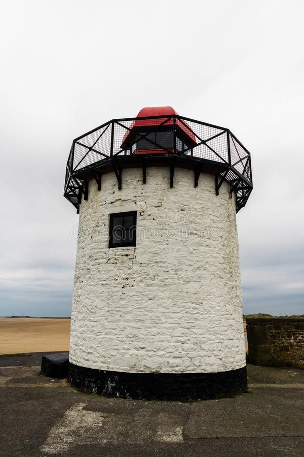 Burry port lighthouse. Small white squat white lighthouse with red top. Burry Port, Llanelli, Carmarthenshire, Wales stock photography