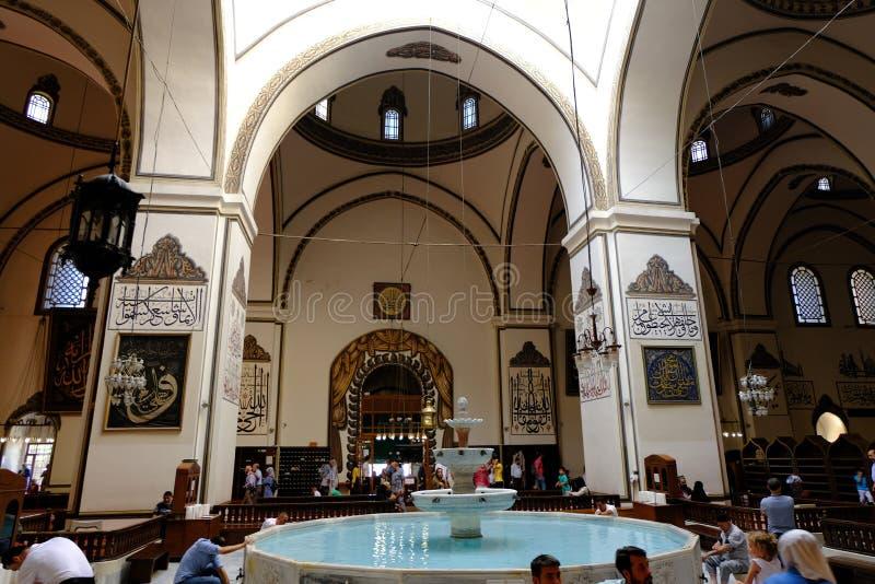 Bursa Grand Mosque or Ulu Cami is a mosque in Bursa, Turkey. Sitting, square. Bursa, Turkey - August 13, 2019: An interior view of Great Mosque Ulu Cami. People stock photo