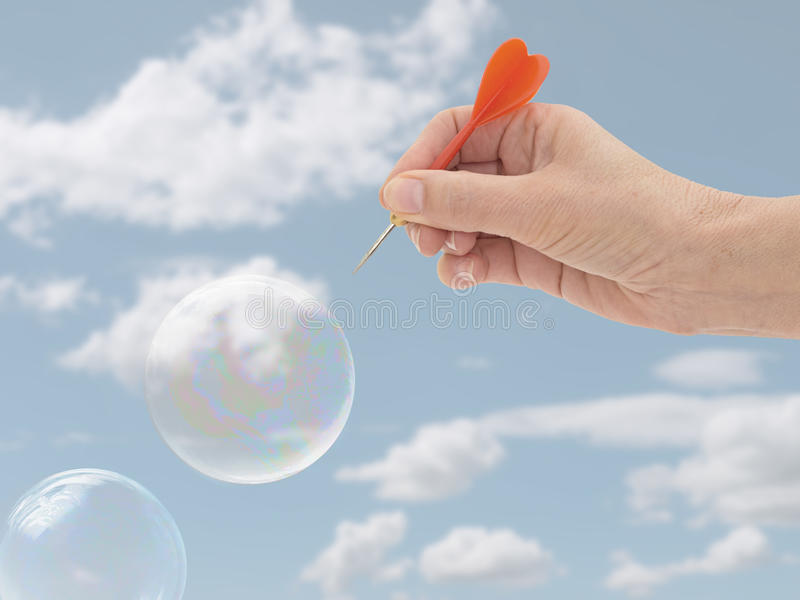 Burst my bubble. Financial or general concept. Woman`s hand. stock images