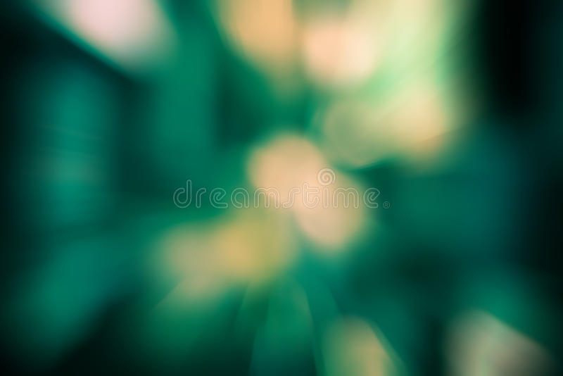 Burst zoom of bokeh light in gradient green and yellow background stock photography