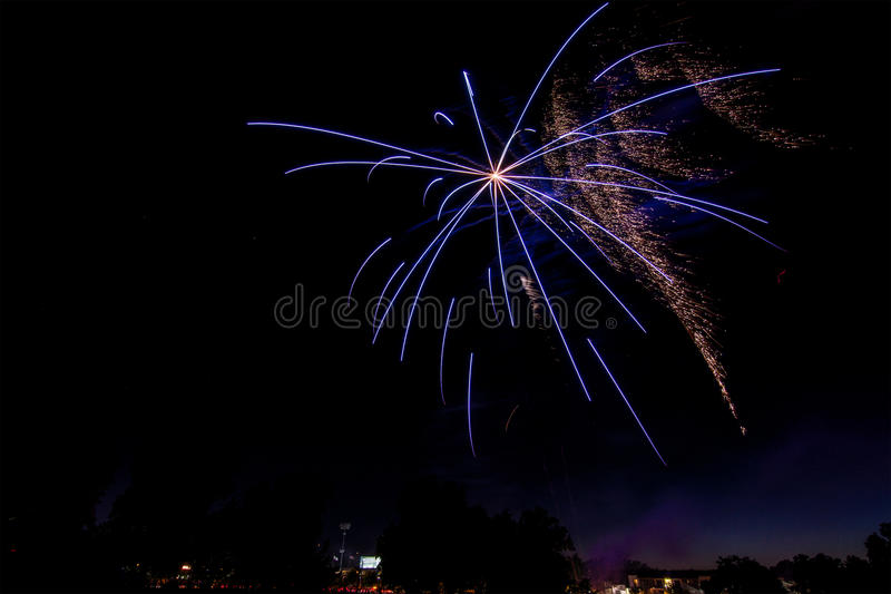 Bursting fireworks against black background stock images