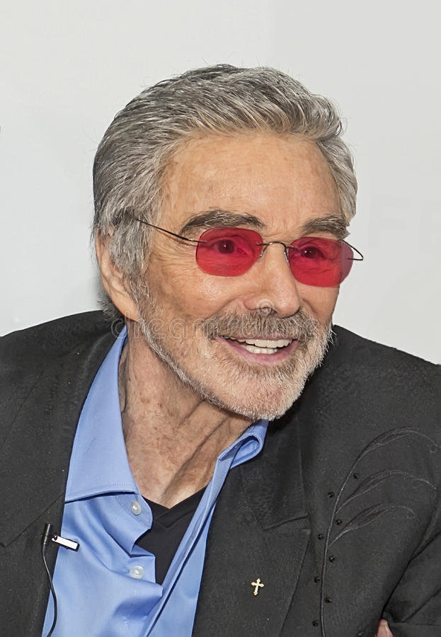"""Burt Reynolds. Actor, producer, and director Burt Reynolds arrives on the red carpet for the premiere of `Dog Years` (later changed to """"The Last Movie stock photo"""
