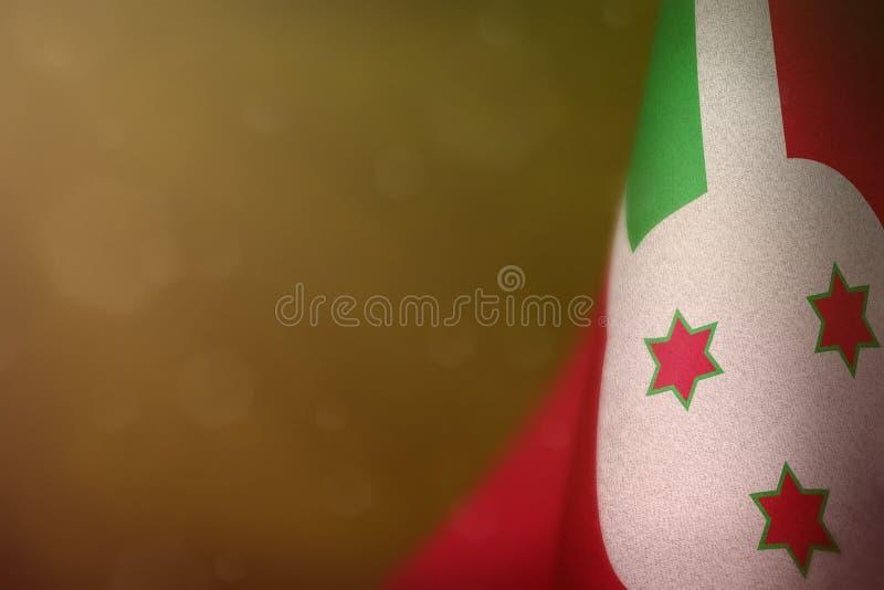 Burundi flag for honour of veterans day or memorial day. Glory to the Burundi heroes of war concept on yellow dark velvet. Burundi hanging flag for honour of royalty free stock image