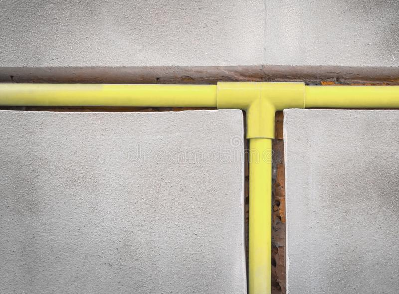 Bury a pvc pipe in the wall royalty free stock photography