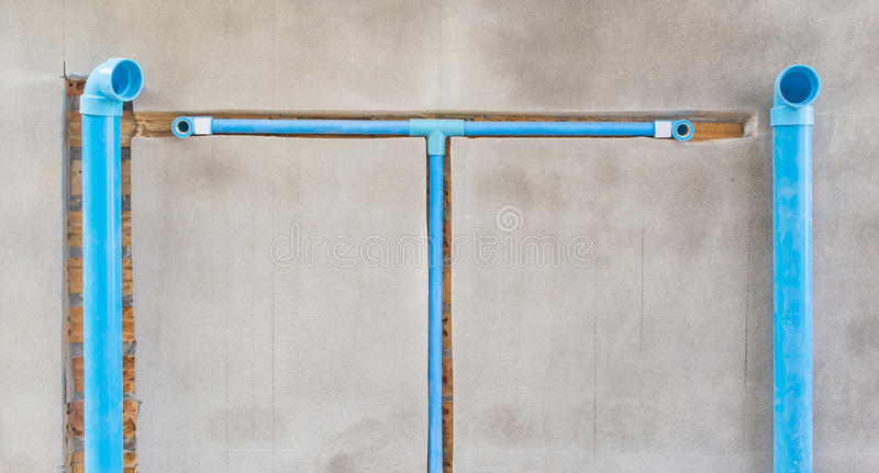 Bury a pvc pipe in the wall stock images