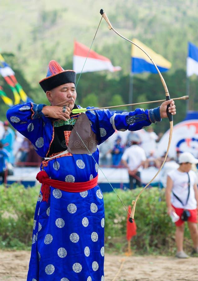 Buryat (Mongolian) archer aims stock images