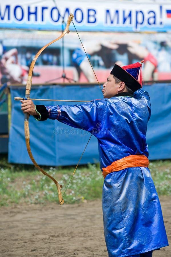 Buryat (Mongolian) archer shoots stock images