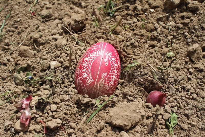 Burying the Old Easter egg in the first furrow of the earth, field. Old Slavic pagan fertility ceremony stock images