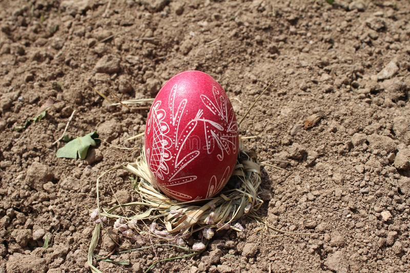 Burying the Old Easter egg in the first furrow of the earth, field. Old Slavic pagan fertility ceremony stock photography