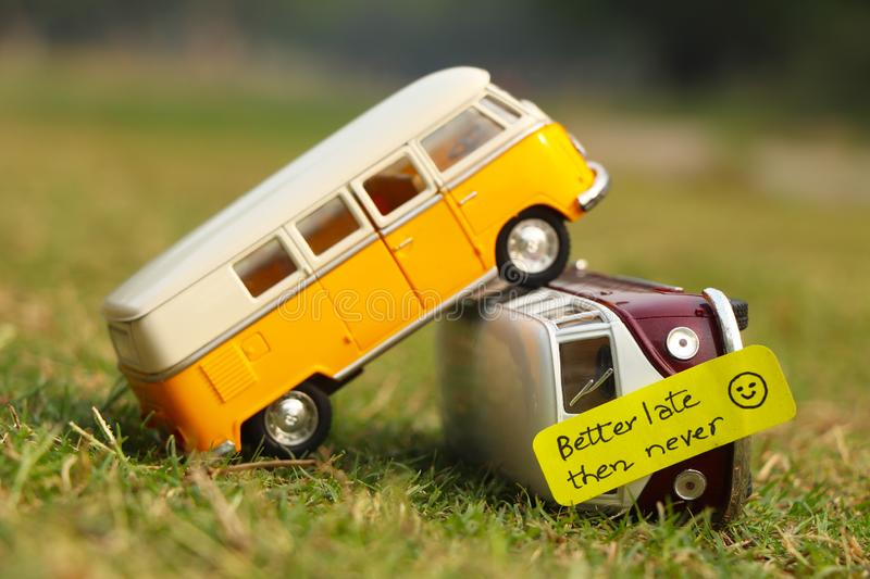 Bus accident concept. Concept shot of Bus accident with a written note of better late then never stock photo