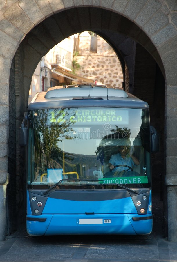 Bus across the wall. In Toledo bus drivers have to pay special attention when driving through the arcades in the city wall so that their vehicles do not get royalty free stock photo