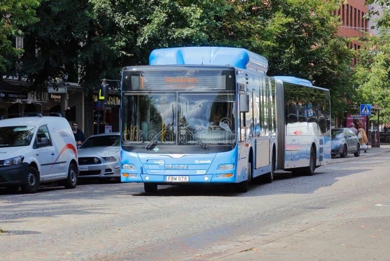 Bus articulé photographie stock libre de droits