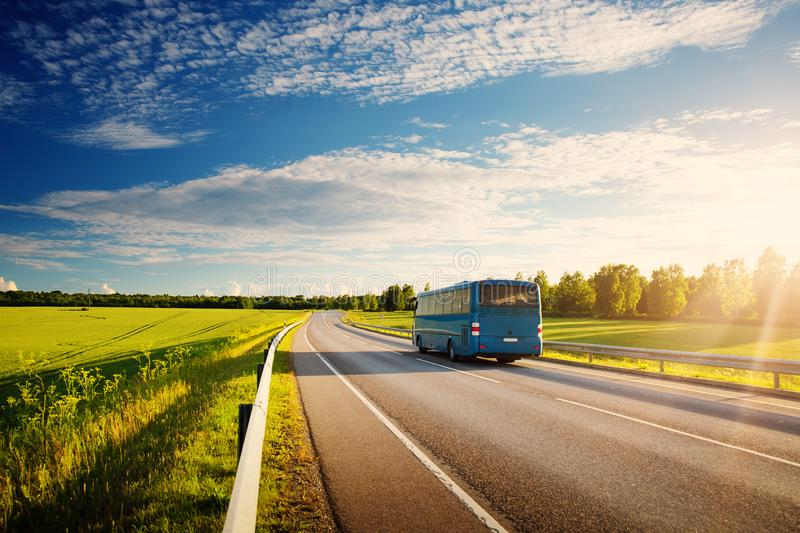 Bus on asphalt road in beautiful spring day. At countryside stock photo