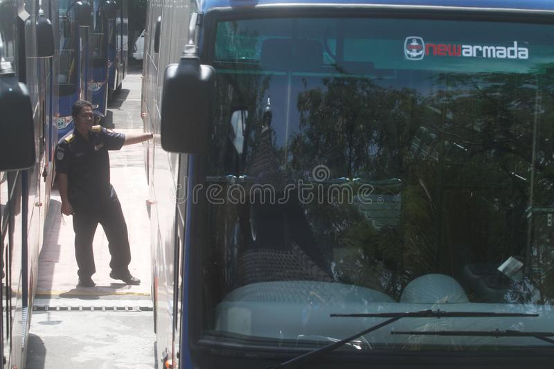 Bus checking. Officer check the bus parked in tirtonadi bus station in solo, central java, indonesia stock images