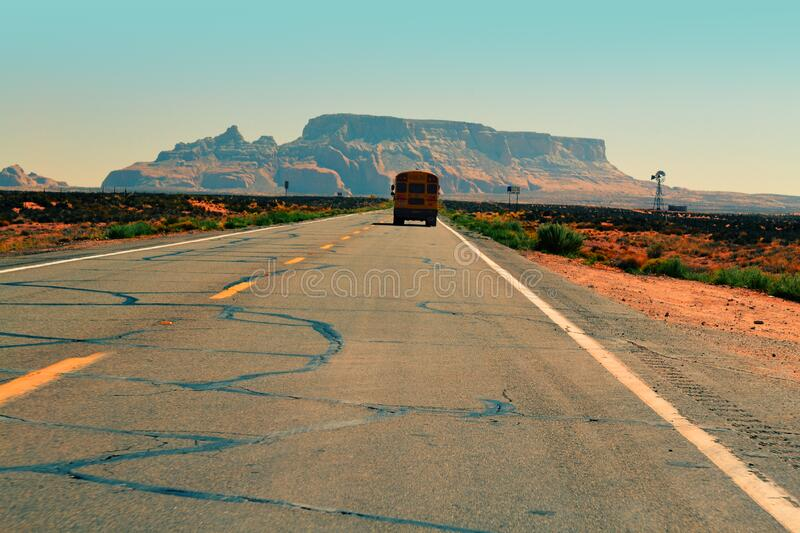 Bus on desert road royalty free stock images