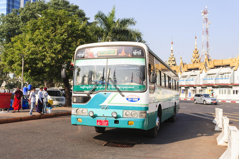 A bus in downtown Yangon, Myanmar. In the middle of a roundabout, Yangon City Hall is located in the heart of Yangon royalty free stock photo