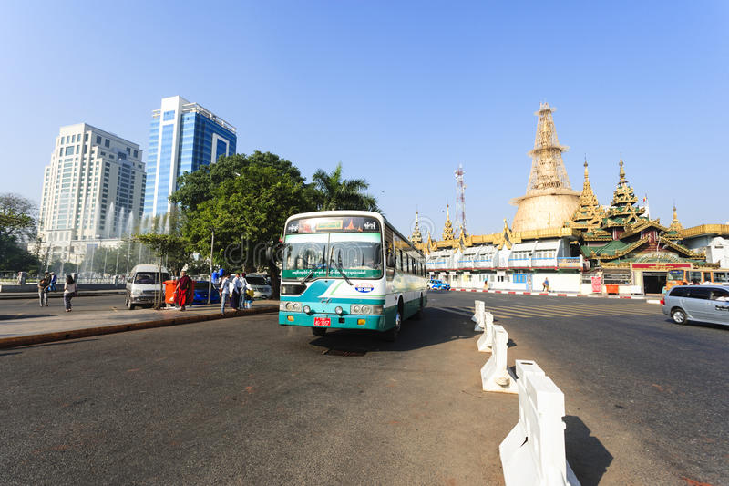 A bus in downtown Yangon, Myanmar. In the middle of a roundabout, Yangon City Hall is located in the heart of Yangon royalty free stock photos