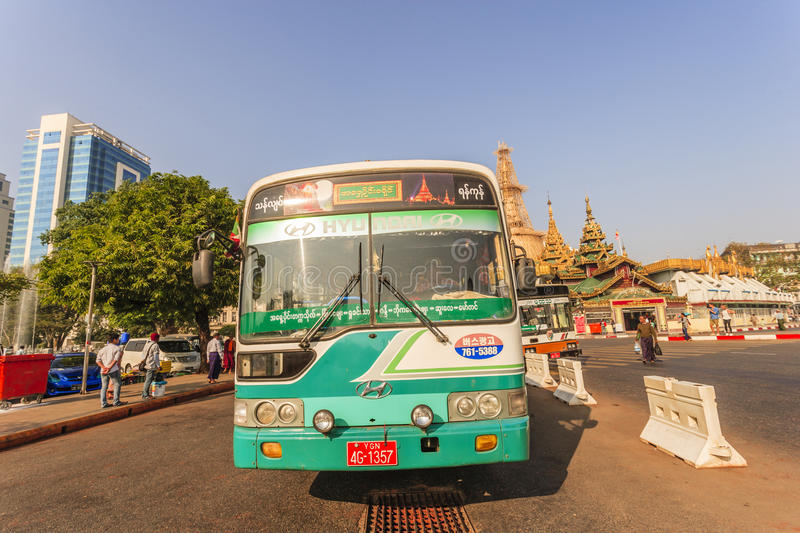 A bus in downtown Yangon, Myanmar. In the middle of a roundabout, Yangon City Hall is located in the heart of Yangon royalty free stock images