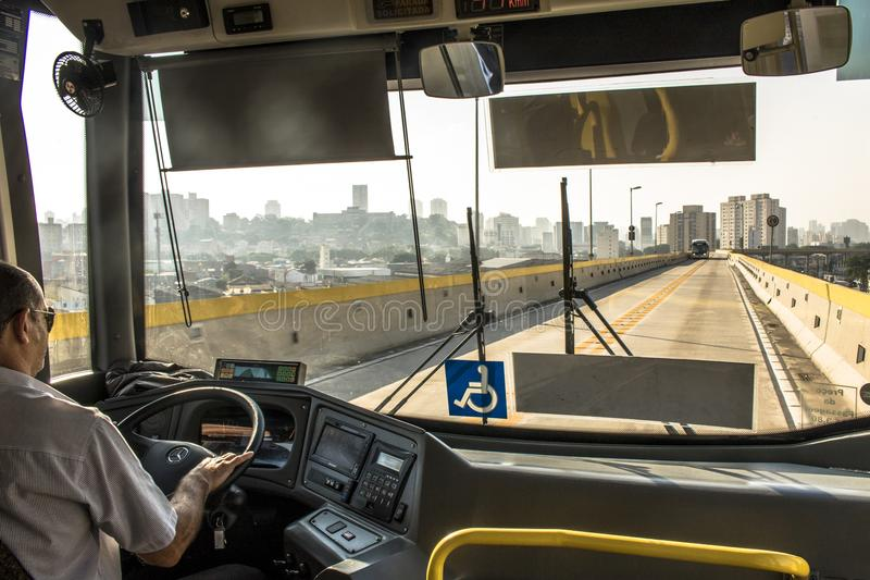 Bus driver. Sao Paulo, SP, Brazil, December 14, 2017. Bus driver drives an articulated bus that travels on the Tiradentes Express, formerly Fura-fila, on the royalty free stock photo
